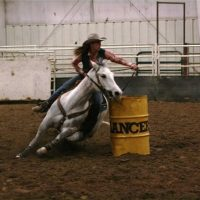 barrel racer at a college rodeo
