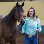 Kylie McGarity shows off her young horse at the student competition.