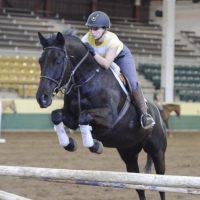 Student riding CSU horse, Mona