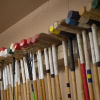 polo mallets hanging on the wall