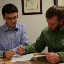 Instructor, Ryan Brooks, helps a student with advising