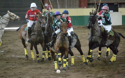 womens polo team playing a match