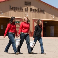 Students walking across the parking lot of the equine center