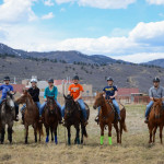 Students in the horse training and sales preparation class on their project horses in the pasture