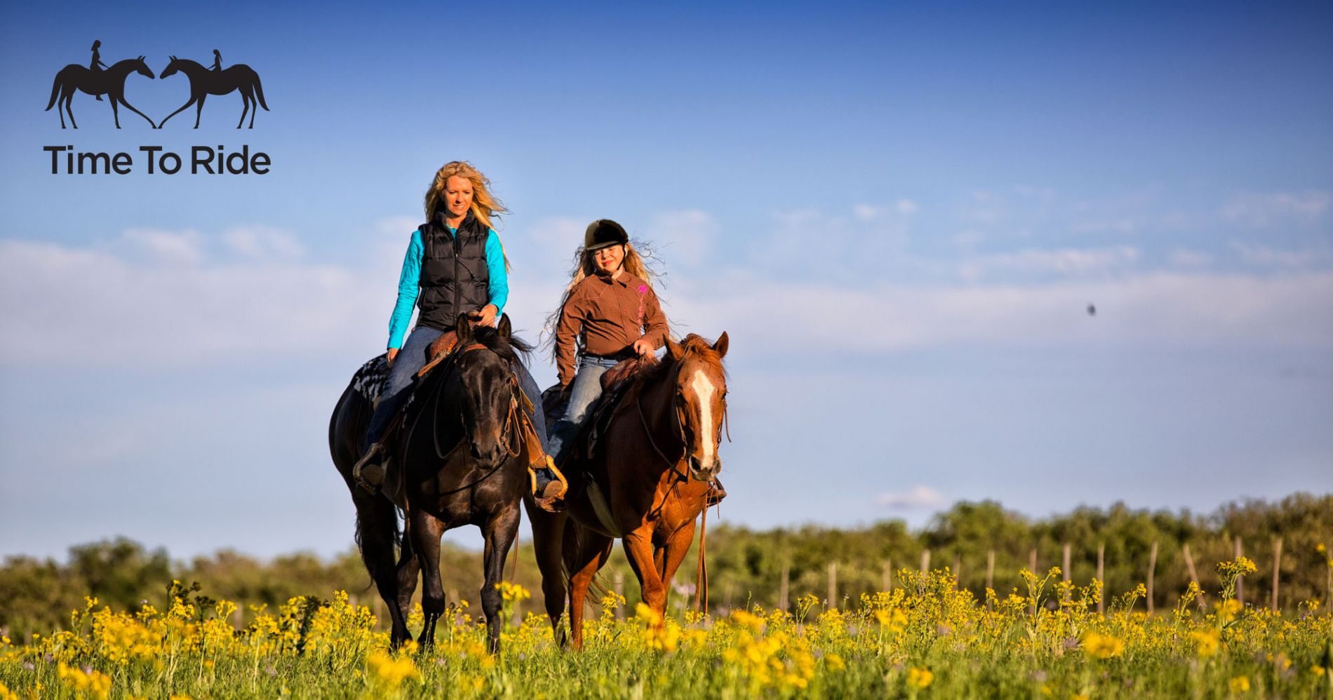 Two people on a trail ride